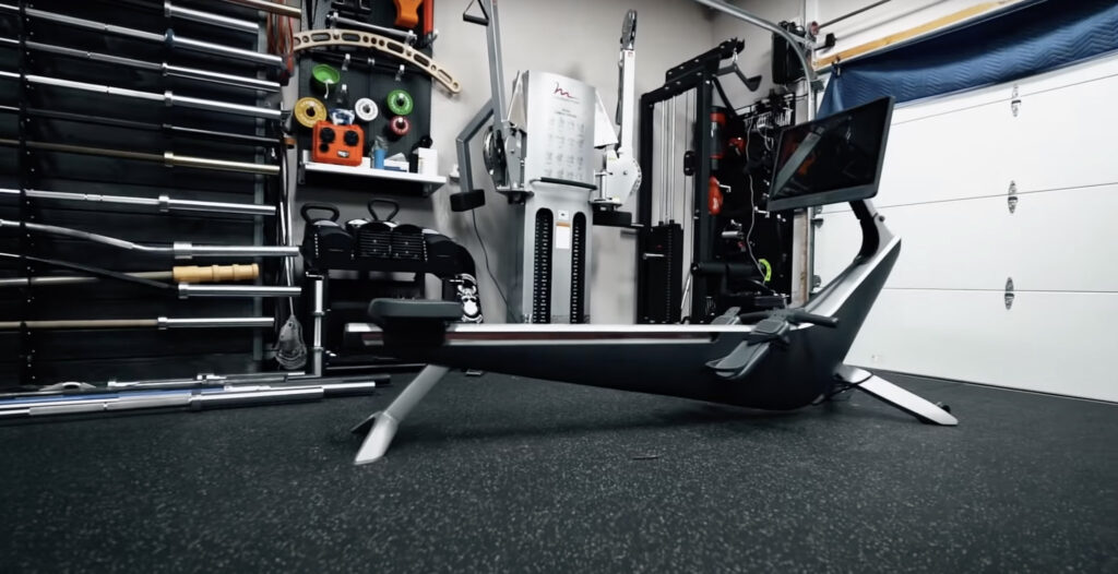 The Hydrow is inside Coop's garage gym. It has sleek lines and is modern looking.