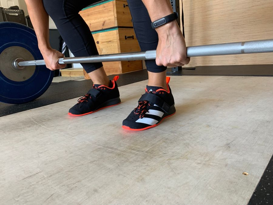 Woman wearing Adidas Adipowers 2 weightlifting shoes during deadlifts