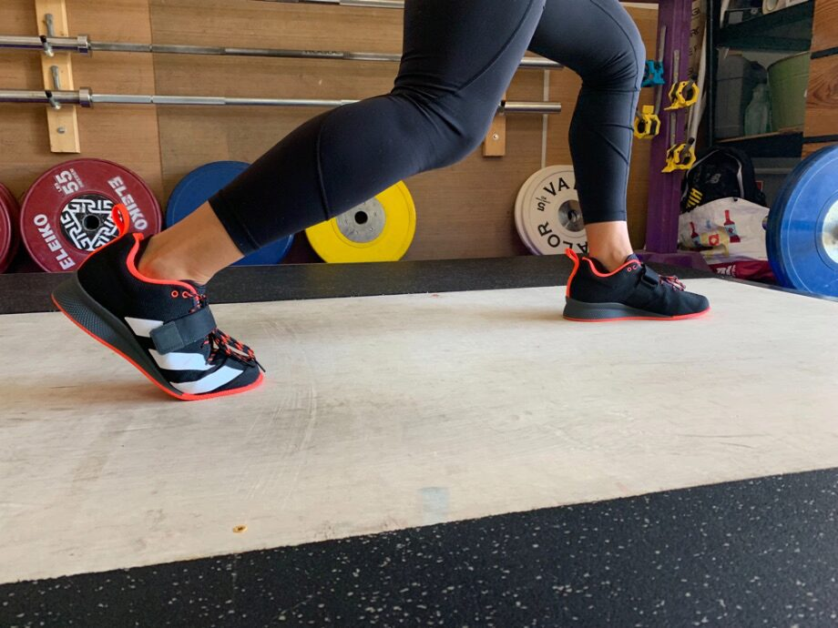 Woman doing a split squat in the Adidas Adipower 2 weightlifting shoes