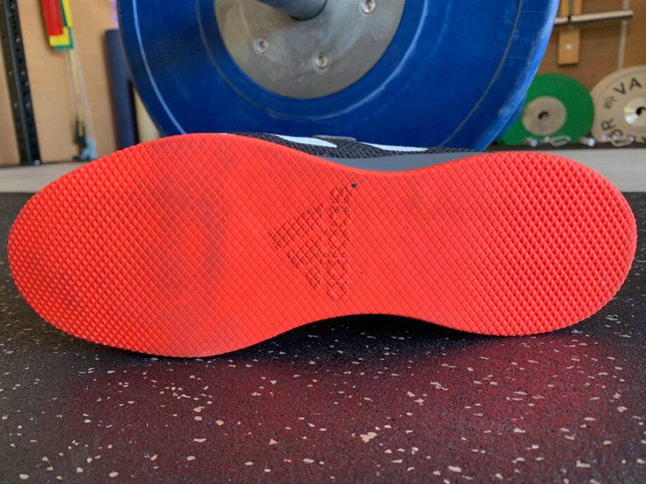 The bright orange tread on the bottom of the Adidas Adipower 2