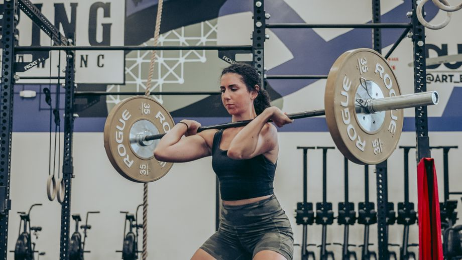 Amanda catching a barbell in the front-rack position