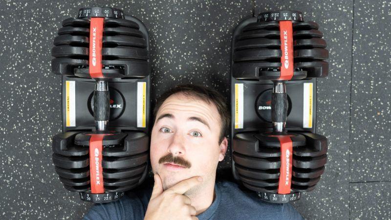 Coop with his head between the BowFlex SelectTech Adjustable Dumbbells
