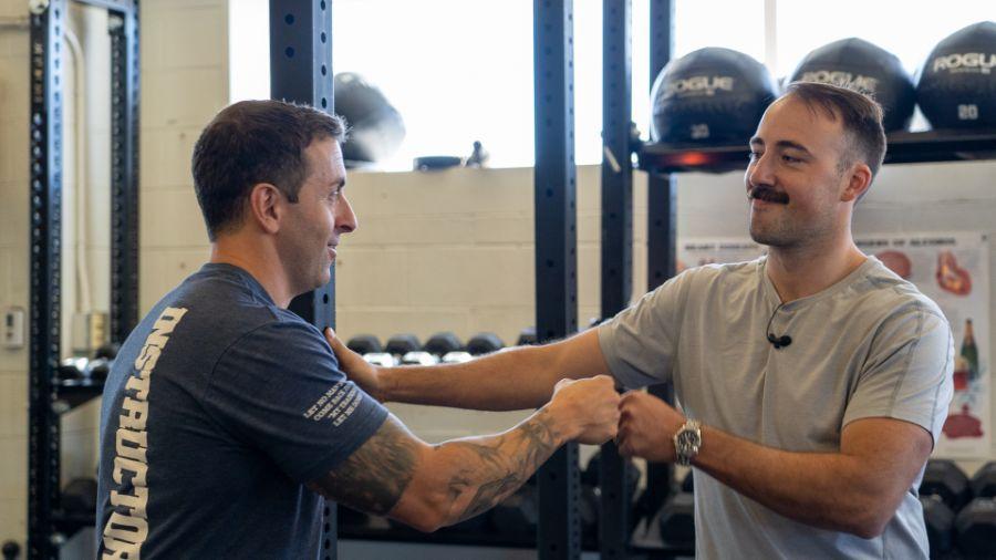 Coop and  Capt. Robert Cefoli of the FDNY doing fist bumps