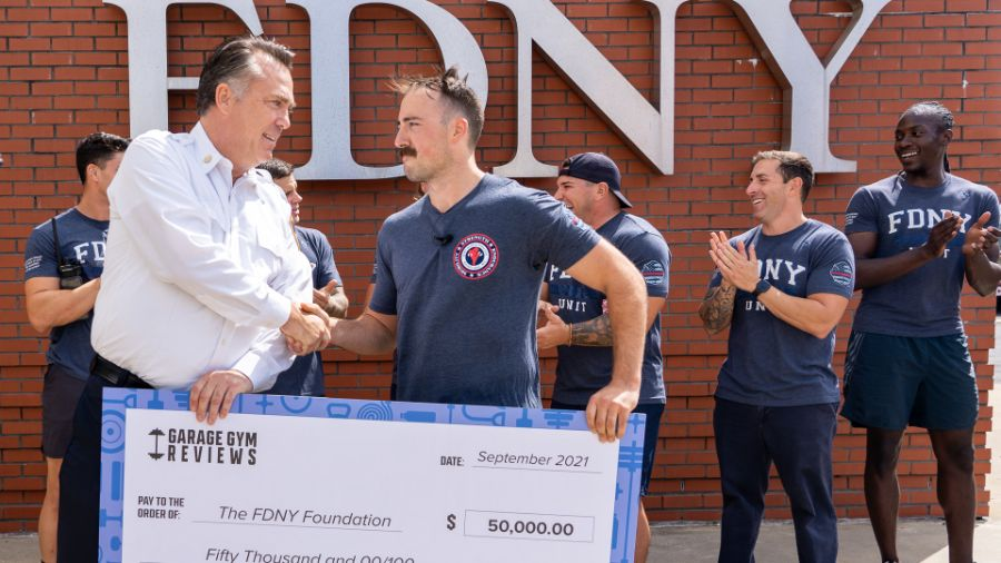 Coop presents a check for $50,000 to the FDNY