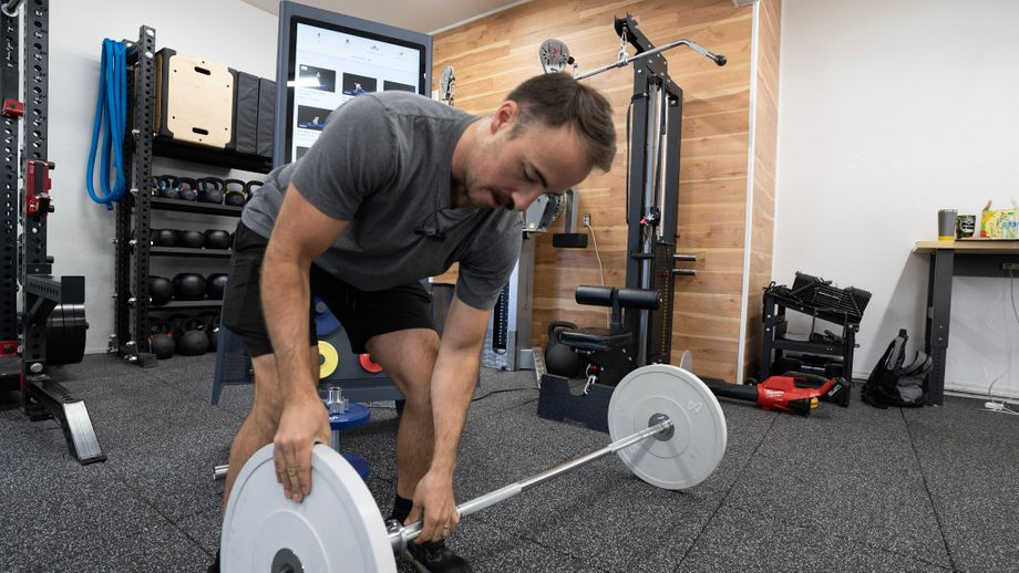 Coop setting up for deadlifts with the Tempo Studio