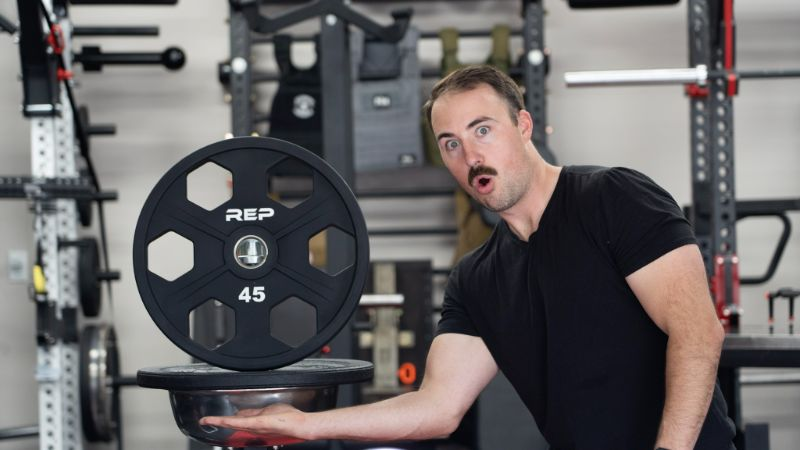 An image of Coop with REP Fitness weight plates