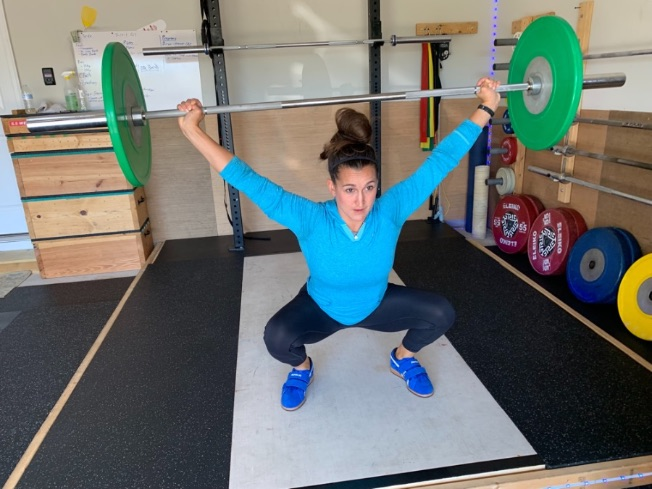 Woman doing overhead squats while wearing the Do-Win Classic Lifter