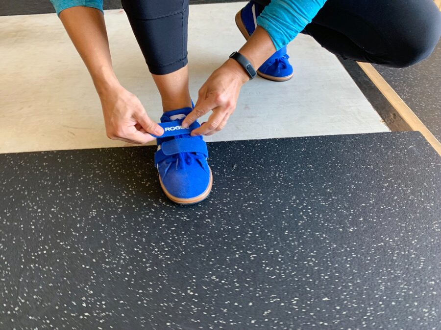 Woman lacing up the Do-Win Classic Lifter