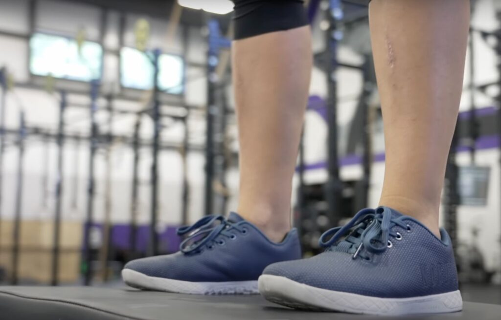 Woman wearing NOBULL training shoes in the gym