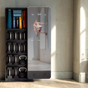 Product image of the NordicTrack Vault showing a workout on the reflective screen, with dumbbells and kettlebells stored on the attached shelving.