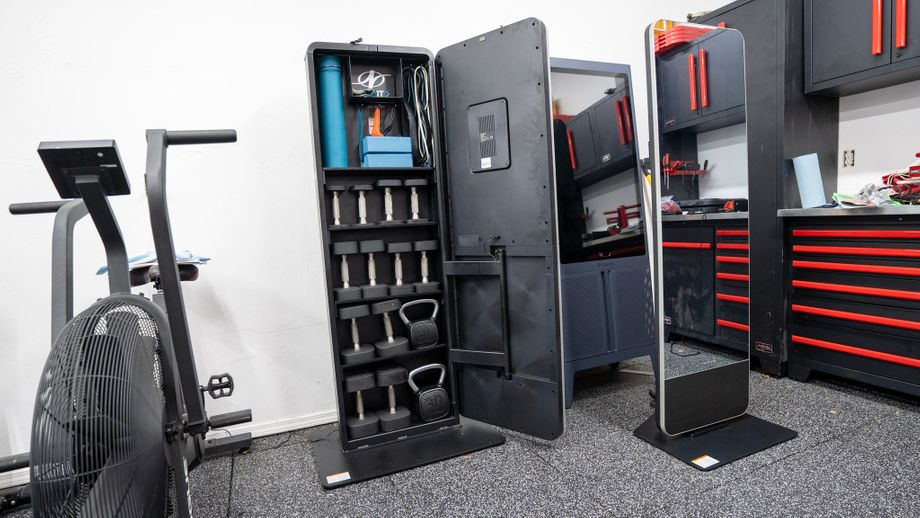 The NordicTrack Vault open to show the storage shelves and equipment