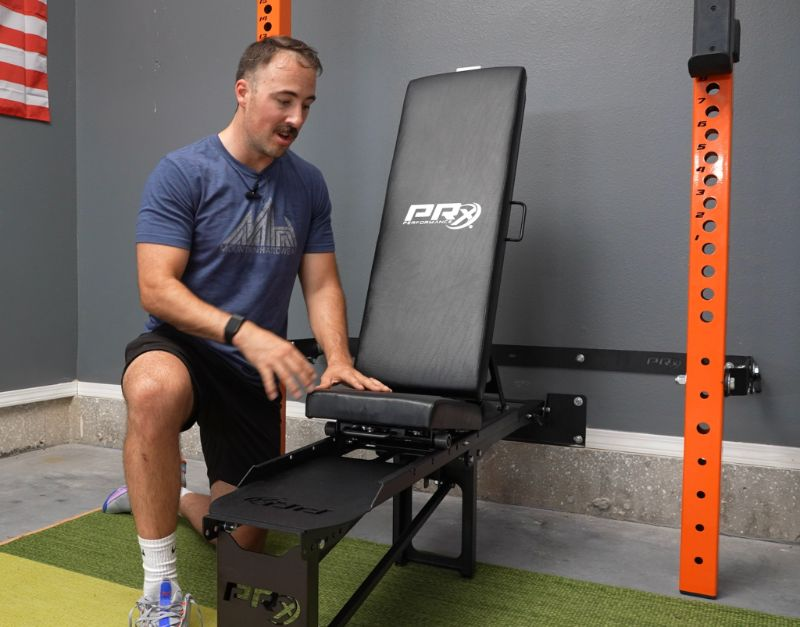 Coop sitting next to the PRx Performance Weight Bench